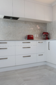 Sleek white cabinetry with Jag Kitchens
